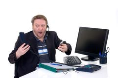Stressed businessman on desk Stock Photography