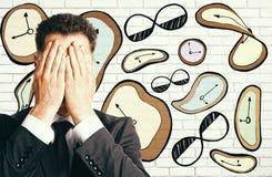 Stressed businessman with drawn clocks Royalty Free Stock Photos