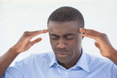 Stressed businessman getting a headache Stock Photography