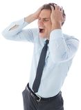 Stressed businessman with hands on head Stock Images