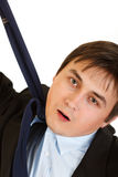 Stressed businessman hanging himself on necktie Royalty Free Stock Photos