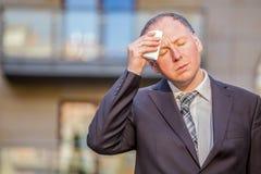 Stressed businessman having headache Stock Photos