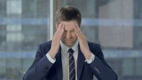 Stressed Businessman Having Headache, Pain in Head stock video footage