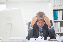 Stressed businessman with head in hands Royalty Free Stock Images