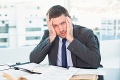 Stressed businessman with head in hands Royalty Free Stock Photo
