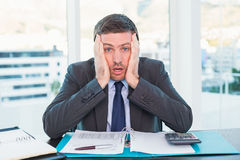 Stressed businessman with head in hands Royalty Free Stock Photography