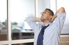 Stressed businessman with head in hands. At office royalty free stock images