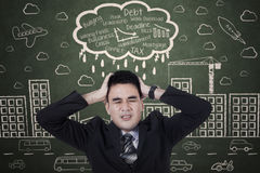 Stressed businessman with a headache Royalty Free Stock Photography
