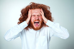 Stressed businessman with a headache Royalty Free Stock Photo