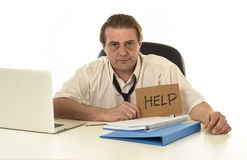 Stressed businessman on his 40s with loose tie and messy look g Royalty Free Stock Photo