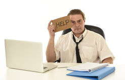 Stressed businessman on his 40s with loose tie and messy look g Stock Photography
