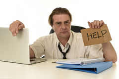 Stressed businessman on his 40s with loose tie and messy look g Stock Photo