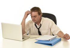 Stressed businessman on his 40s with loose tie and messy look g Stock Photos