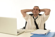 Stressed businessman on his 40s with loose tie and messy look g Royalty Free Stock Photography