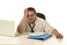 Stressed businessman on his 40s with loose tie and messy look g Stock Images