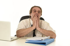 Stressed businessman on his 40s with loose tie and messy look gesturing desperate overworked Royalty Free Stock Photos