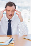 Stressed businessman holding his head Royalty Free Stock Photography