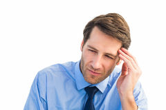 Stressed businessman holding his head. On white background Royalty Free Stock Photo