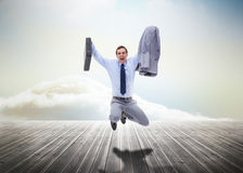 Stressed businessman jumping over wooden boards Stock Photo