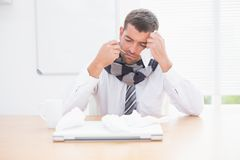Stressed businessman looking down Royalty Free Stock Photography