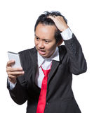 Stressed businessman looking tablet concept strain with result Royalty Free Stock Image