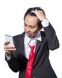 Stressed businessman looking tablet , concept strain with the result Royalty Free Stock Photos