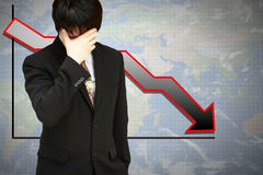 Stressed businessman with low financial graph Stock Image