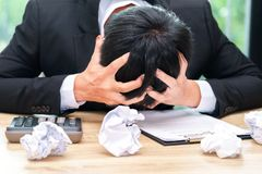 Stressed businessman make a mistake with chewed paper - migraine. Or headache concept Royalty Free Stock Photo