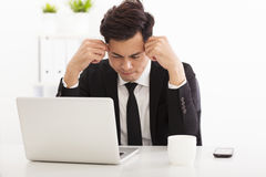 Stressed businessman in the office Stock Photography