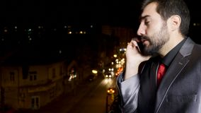 Stressed businessman on the phone. Explaining something to a employee stock footage