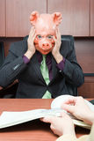 Stressed businessman in pig mask Royalty Free Stock Photography