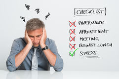 Stressed Businessman. Portrait Of Stressed Businessman With Too Many Tasks To Do At Office Royalty Free Stock Image
