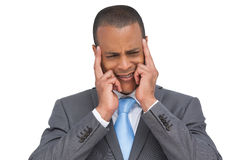 Stressed businessman putting his fingers on his temples Royalty Free Stock Photography