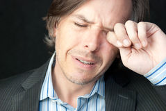 Stressed Businessman Rubs Eyes Royalty Free Stock Photos