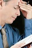 Stressed Businessman Rubs Forehead Royalty Free Stock Photos