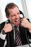 Stressed businessman screaming on the phone Stock Photo