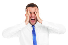 Stressed businessman screaming Royalty Free Stock Images