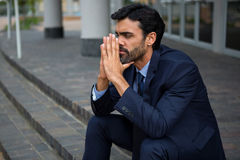 Stressed businessman sitting on steps Stock Images