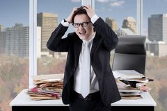 Stressed businessman standing in the office Stock Photography