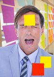 Stressed businessman with sticky notes on forehead Stock Images