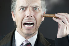 Stressed Businessman Stubs Out Cigar On Face Royalty Free Stock Photo