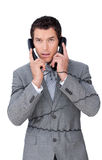Stressed businessman tangle up in telephone wires Royalty Free Stock Photography