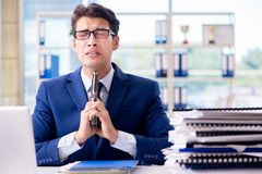 Stressed businessman thinking of suicide due to excessive worklo. Ad Royalty Free Stock Photo