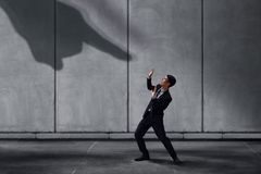 Stressed Businessman in Under Pressured Concept, Small Worker Sc. Ared a Shadow of Huge Pointing Hand. Terrible Boss or Customer Royalty Free Stock Photos