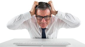 Stressed businessman using a keyboard Stock Photography