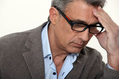 Stressed businessman wearing glasses Royalty Free Stock Photos