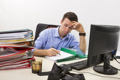 Stressed businessman at work Stock Photo