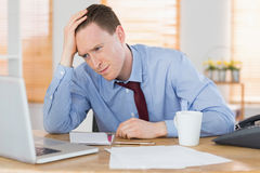 Stressed businessman working at his desk Stock Photography