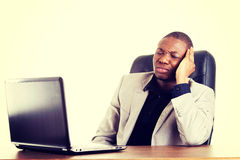 Stressed businessman working on laptop Royalty Free Stock Photography