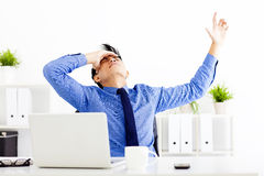 Stressed businessman working in the office Stock Image